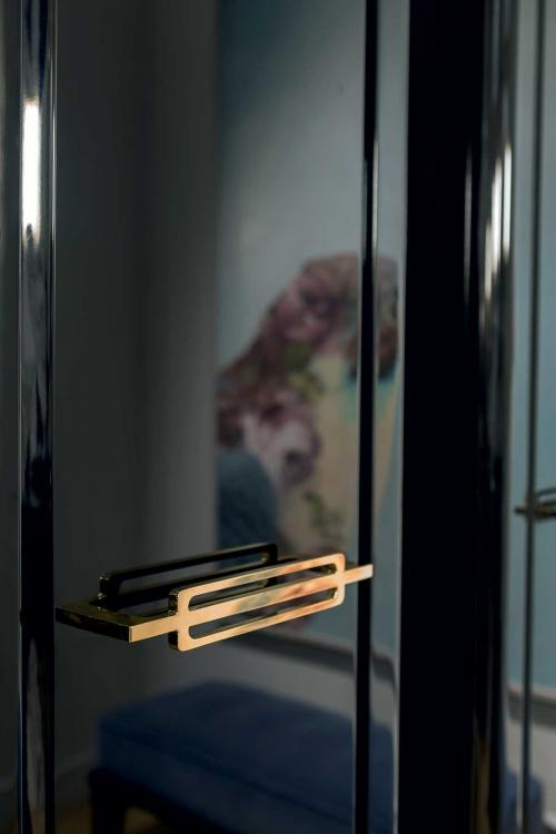 Riviere tall unit, Black finish, gold  metal handle